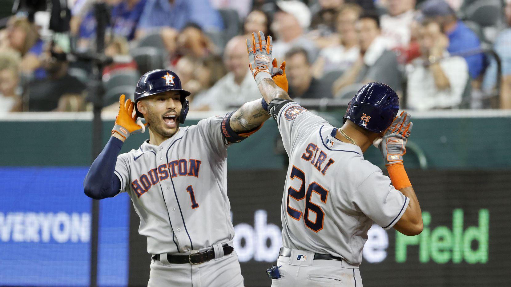 Houston Astros' Carlos Correa (1) celebrates his three-run home run against the Texas Rangers with Jose Siri (26) during the fourth inning of an MLB baseball game in Arlington, Texas on Thursday, Sept. 16, 2021.
