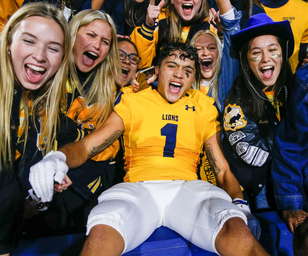 McKinney's Isaiah Rojas (1) celebrates with fans following their win over McKinney Boyd in a high school football matchup at McKinney ISD Stadium on Friday, Nov. 8, 2019 in McKinney, Texas. (Ryan Michalesko/The Dallas Morning News)