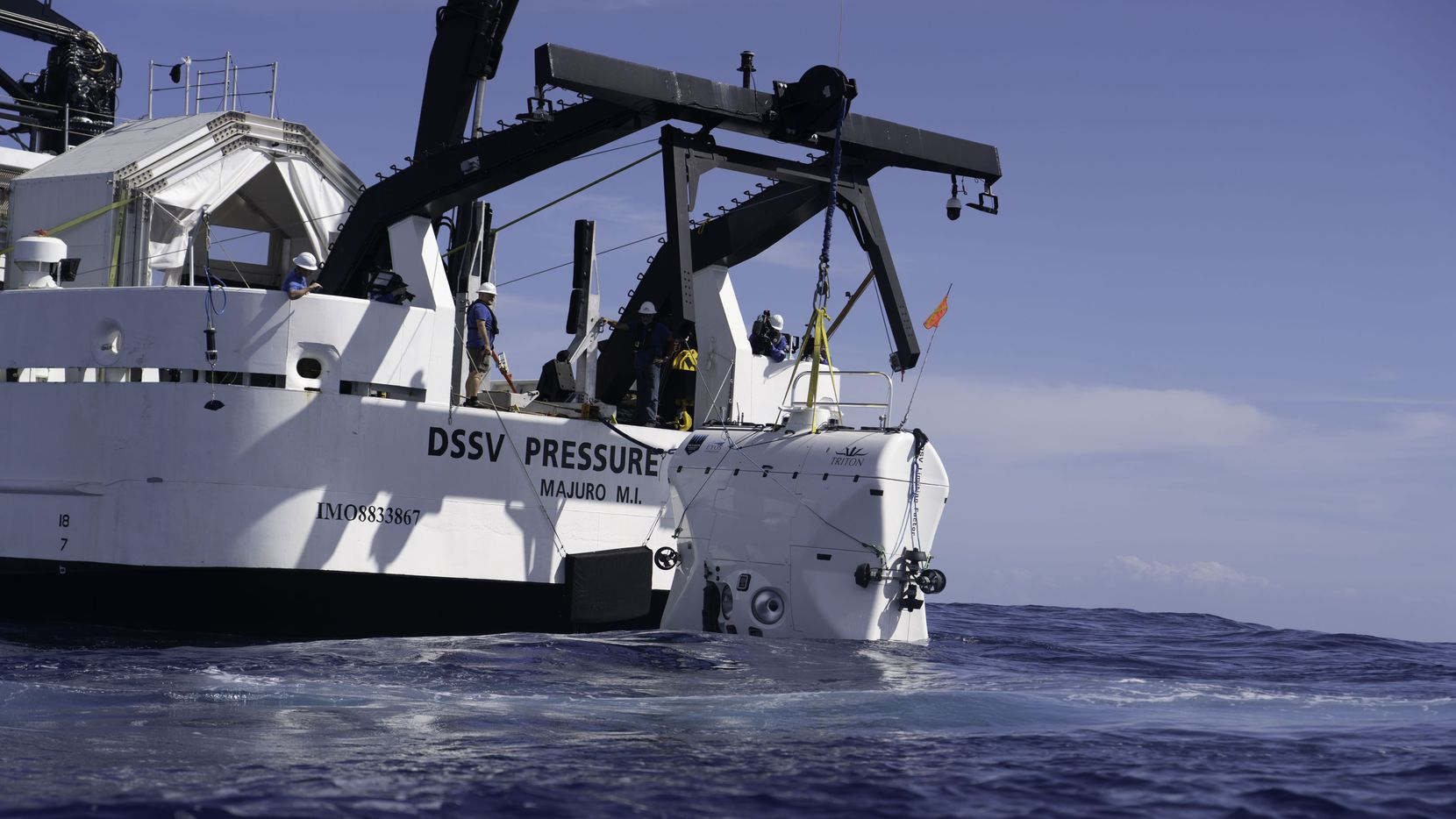 The Five Deeps Expedition lowers the Limiting Factor submersible into the ocean off the coast of Puerto Rico.