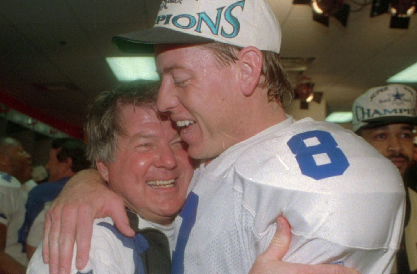 Dallas Cowboys head coach Jimmy Johnson hugs quarterback Troy Aikman in their locker room after beating the Buffalo Bills 30-13 in Super Bowl XXVIII at Atlanta's Georgia Dome, Jan. 30, 1994.