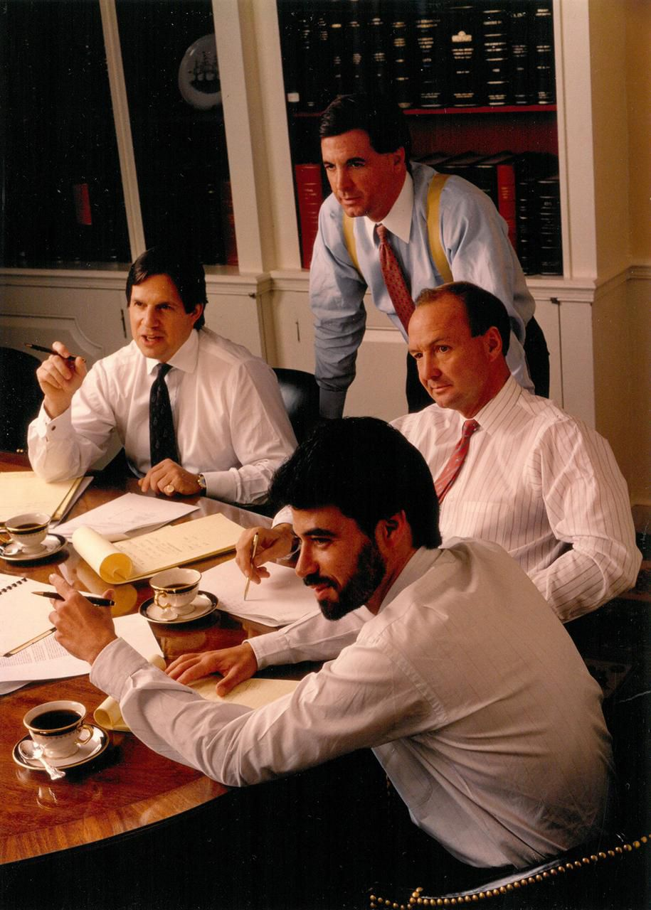 Tom Hicks (right), Bobby Haas (front), Doug Wheat (standing) and Wheat's partner, Peter Grauer, are shown during the negotiations to buy Dr Pepper/7UP in 1987.