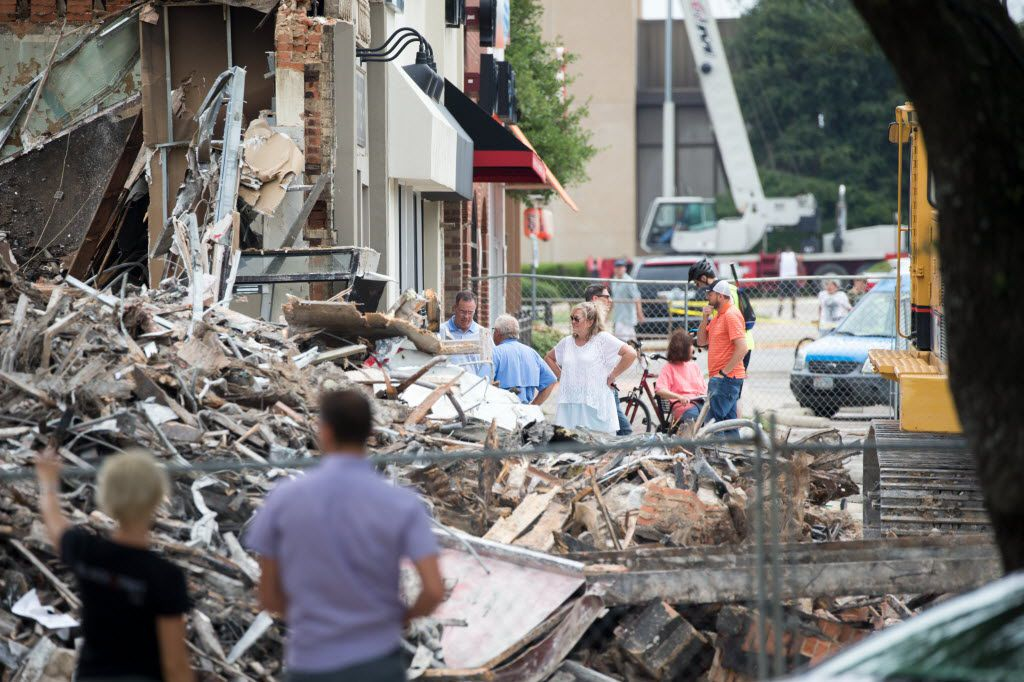 The owners of Goff's Hamburgers surveyed the remains after the restaurant was demolished Saturday. Goff's, a University Park institution, was hit Friday by a three-alarm fire. (Ting Shen/Staff Photographer)