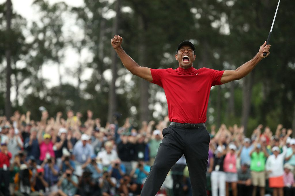 Tiger Woods celebrates after winning the Masters during the final round on Sunday, April 14, 2019, at Augusta National Golf Club in Augusta, Ga. (Jason Getz/Atlanta Journal-Constitution/TNS)