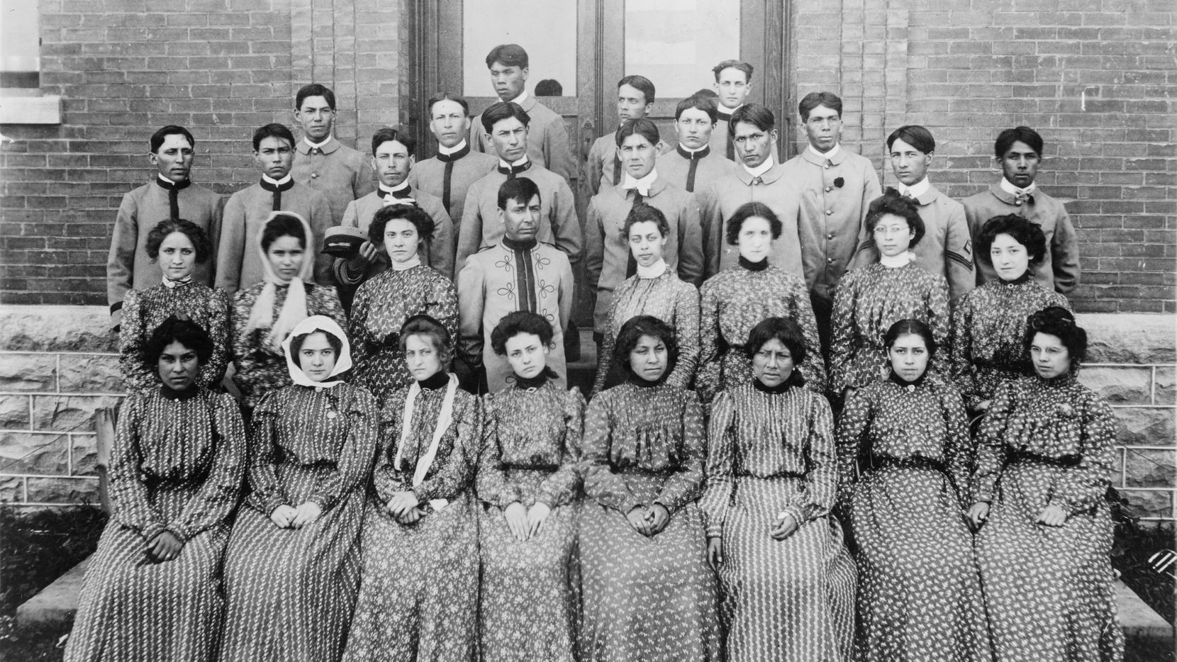"""""""Flandreau Indian School, South Dakota, choir,"""" ca. 1909-1932. The photograph is on view as part of the exhibit """"Away From Home: Indian Boarding School Stories,"""" on view at the Irving Archives and Museum."""
