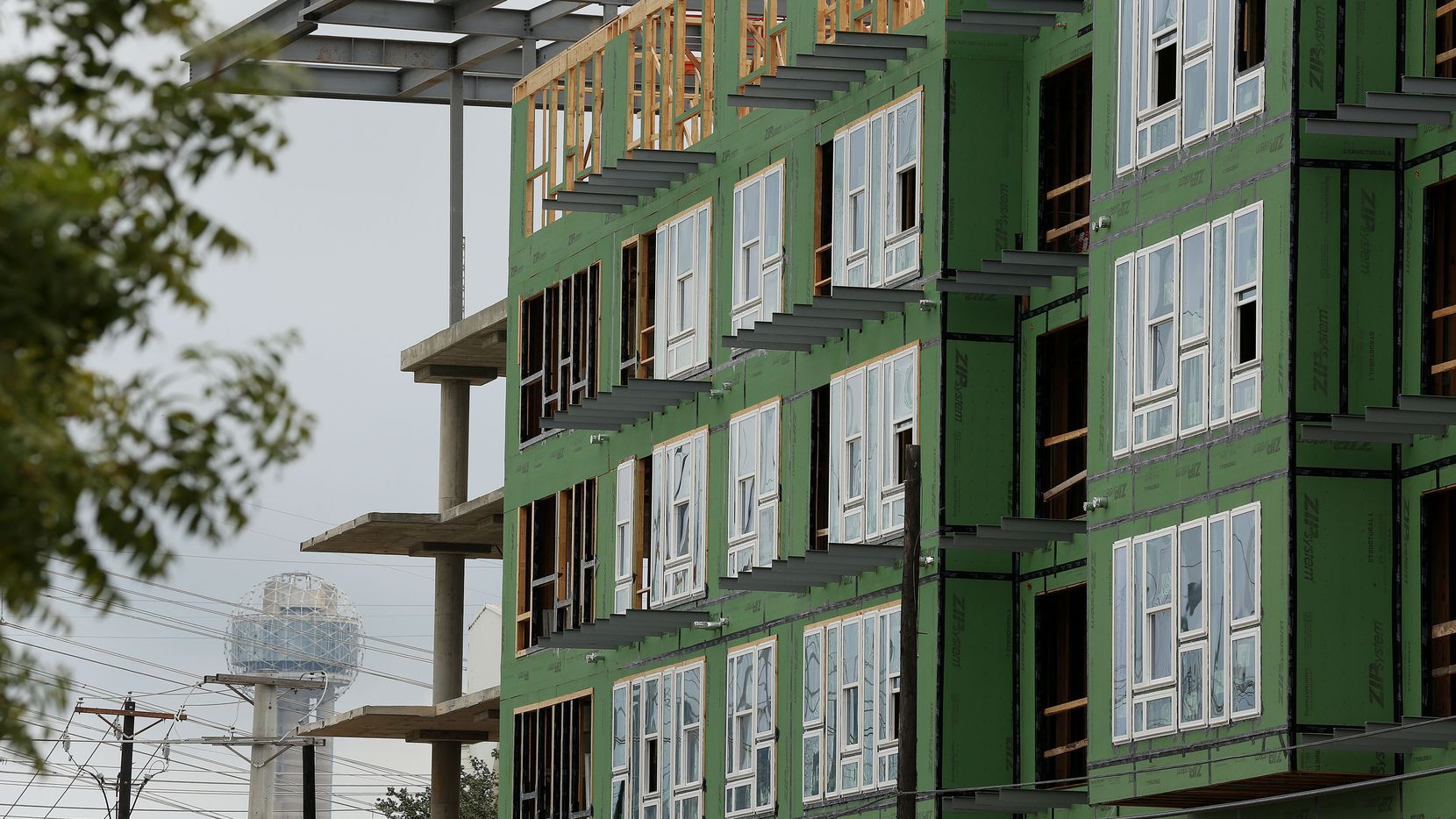 Widespread apartment construction in the Dallas-area is keeping landlords from big rent hikes.