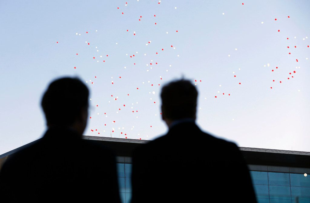 Jim Lentz, CEO of Toyota Motor North America, and Michael Groff, president and CEO of Toyota Financial Services, watch balloons float away during a brief ceremony welcoming employees to the new Toyota North American headquarters in Plano on Monday, May 15, 2017. This is the day the first wave of employees reported to the new facility.
