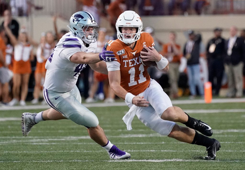 Texas' Sam Ehlinger (11) runs past Kansas State's Kyle Ball (44) during the second half of an NCAA college football game in Austin, Texas, Saturday, Nov. 9, 2019. (AP Photo/Chuck Burton)