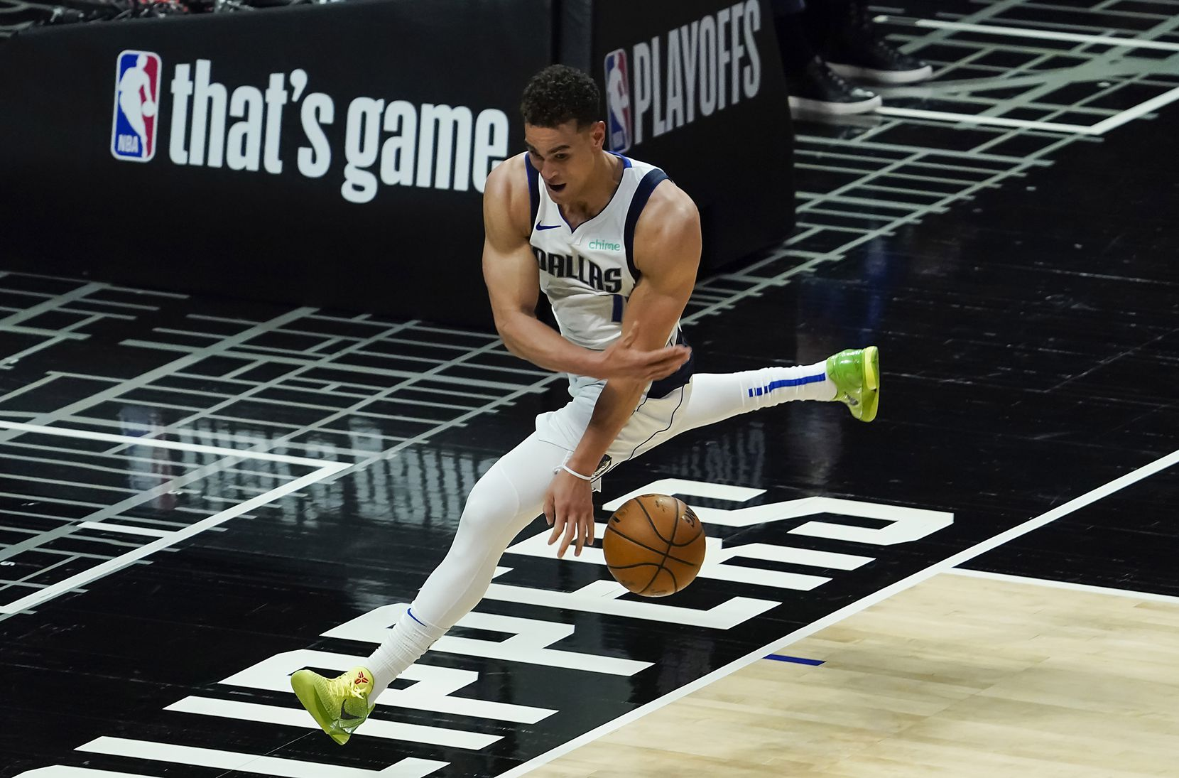 Dallas Mavericks center Dwight Powell tries to save a ball from going out of bounds during the fourth quarter of an NBA playoff basketball game against the LA Clippers at the Staples Center on Wednesday, June 2, 2021, in Los Angeles. The Mavericks won the game 105-100. (Smiley N. Pool/The Dallas Morning News)