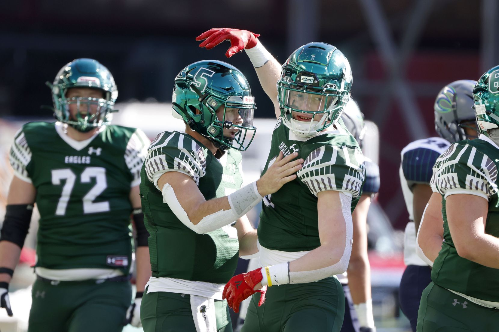 Prosper quarterback Jackson Berry (5), left, celebrates his rushing touchdown against Northwest Eaton with tight end Cameron Harpole (9) during the Class 6A Division II Region I semifinal high school football playoff game on Dec. 26, 2020. (Michael Ainsworth/Special Contributor)
