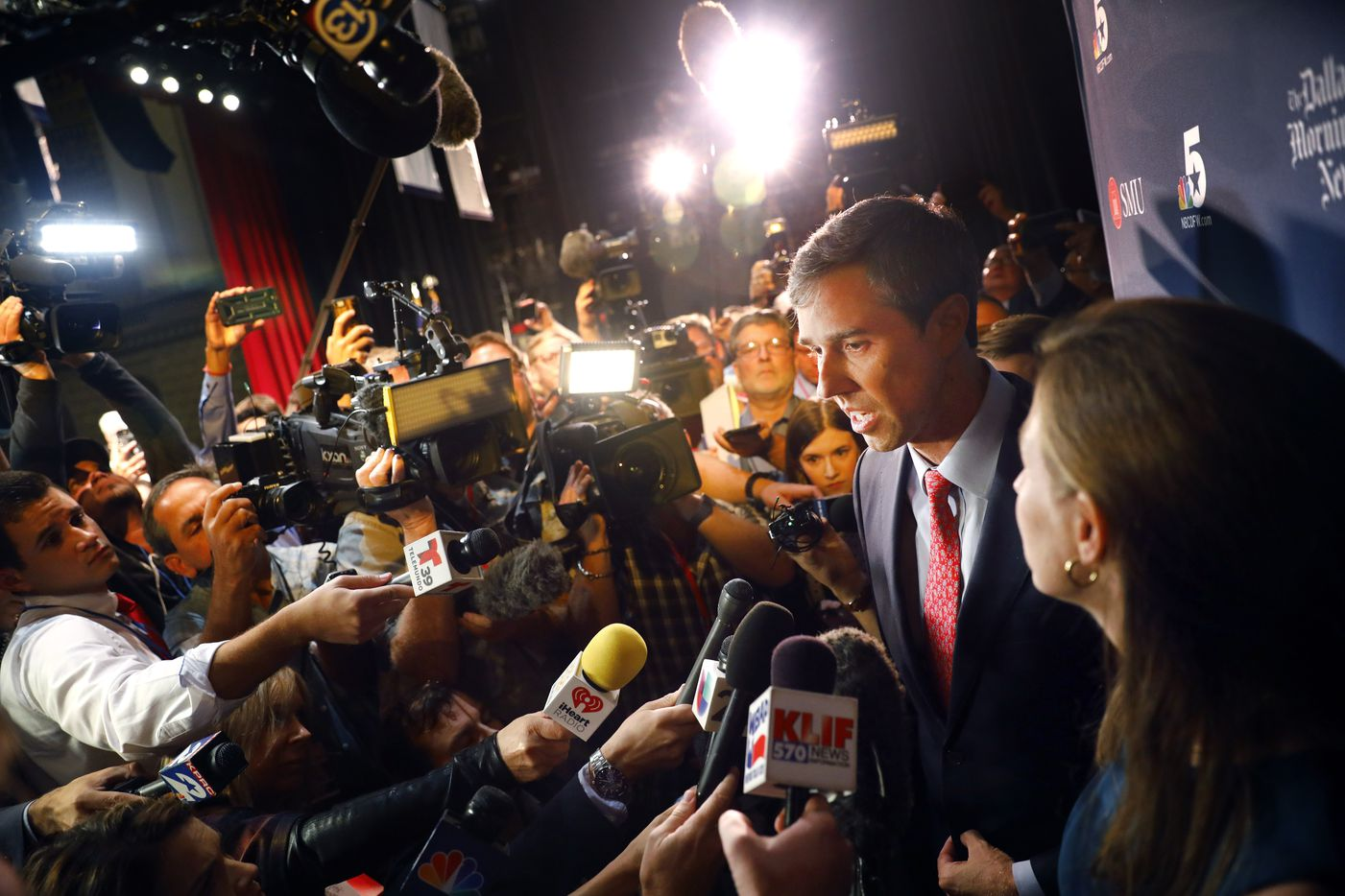 Alongside his wife Amy Hoover Sanders (right), Rep. Beto O'Rourke (D-TX) answers questions from the media following his debate with Sen. Ted Cruz (R-TX) in McFarlin Auditorium at SMU in University Park, Friday, September 21, 2018. Cruz did not participate in post debate interviews.