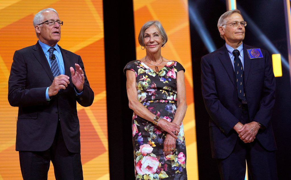 Alice Walton (center) shares the stage at Walmart's annual meeting in June with brothers Rob (left) and Jim. The Waltons rank among the nation's wealthiest people.