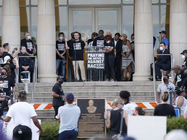 """The crowd listens to speakers during """"A Gathering of Our Collin County Churches,"""" at the Collin County Courthouse in McKinney, Texas on Thursday, June 4, 2020. Churches in Collin county joined to spread a message of unity and love for justice and thoughts on racism."""