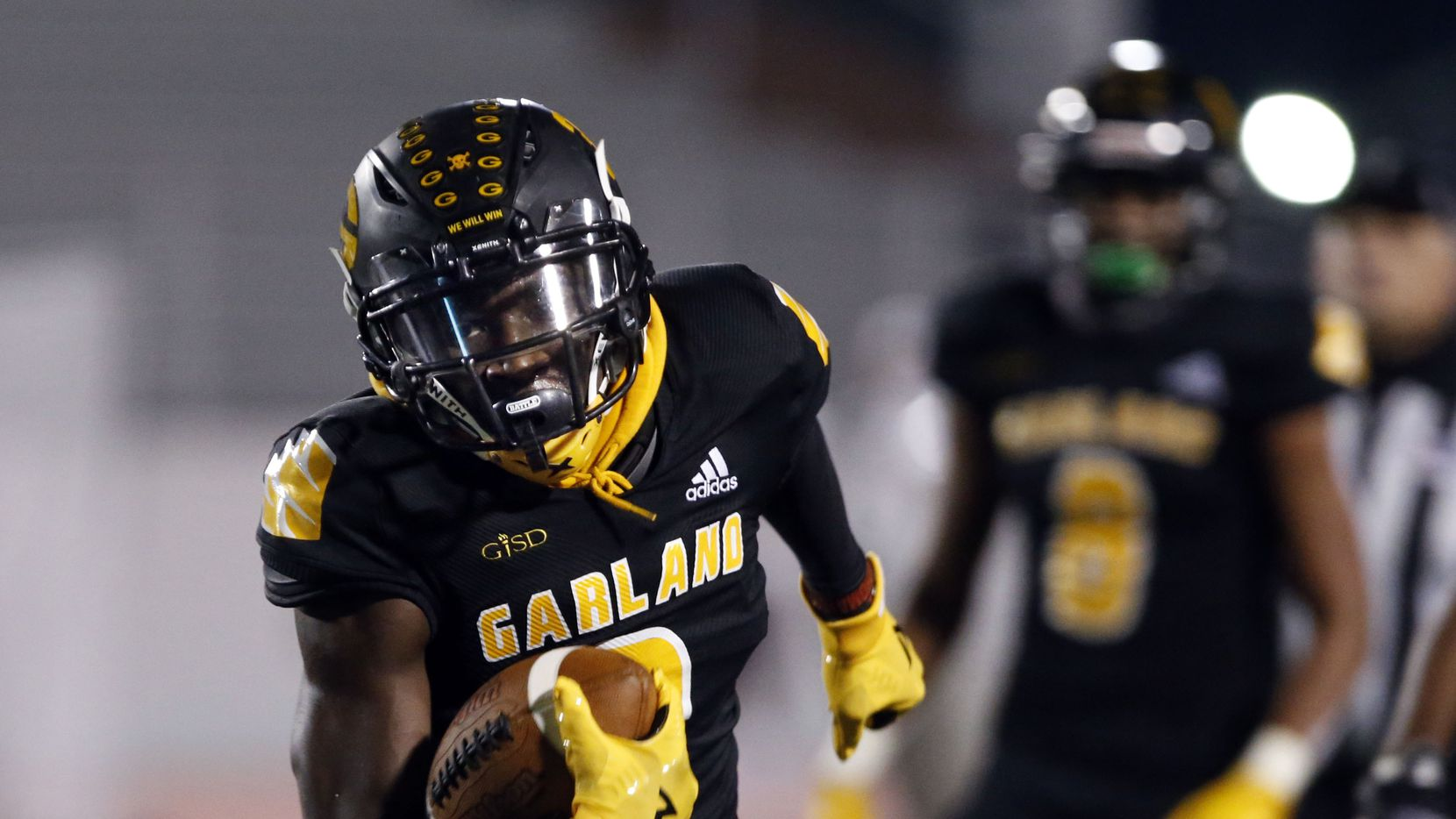 Garland's Jordan Hudson (3) picks up a couple of yards during the first half of high school football game against Rowlett at Williams Stadium in Garland on Friday, November 6, 2020.