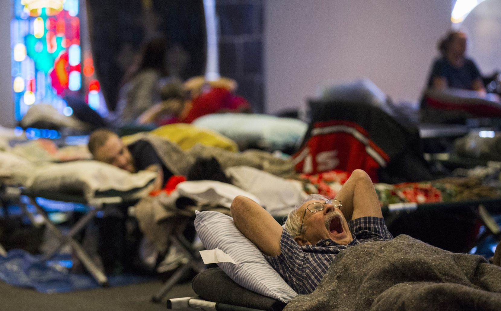 Evacuees rest on cots in a shelter at Woodcrest Church after their homes were damaged from rising flood waters due to Tropical Storm Harvey on Wednesday, August 30, 2017 in Lumberton, Texas.