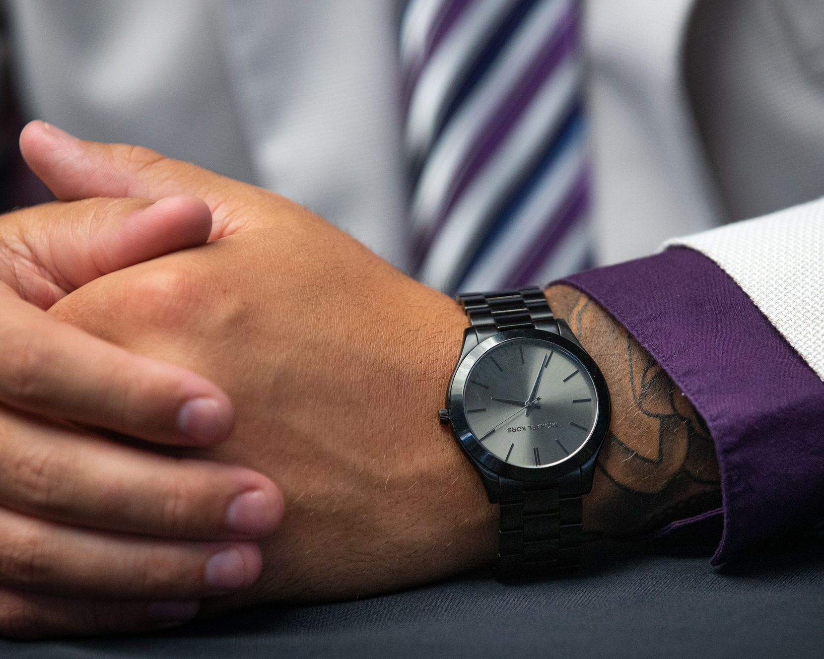 Trey Dishon, defensive tackle for Kansas State University, wears a Michael Kors watch during the Big 12 Conference Media Days event at the AT&T Stadium in Arlington on July 16, 2019.