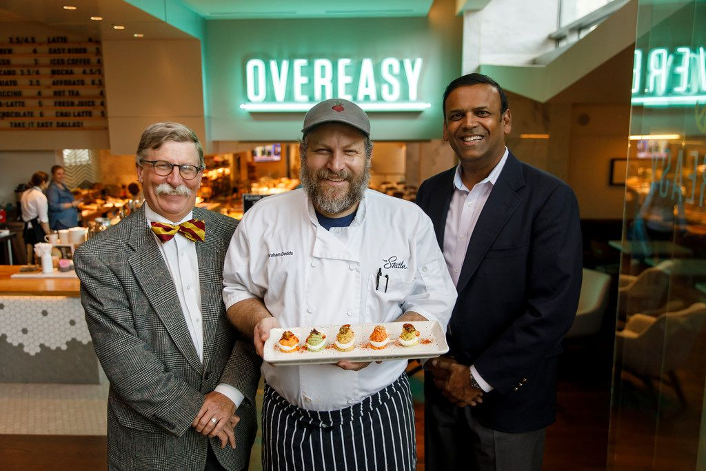 Chef Graham Dodds (center) photographed at his restaurant Overeasy with Bill Holston (left), executive director of Human Rights Initiative of North Texas, and Sanjeeb Samanta, HRI board member, on Friday, Dec. 1, 2017, in Dallas. (Smiley N. Pool/The Dallas Morning News)