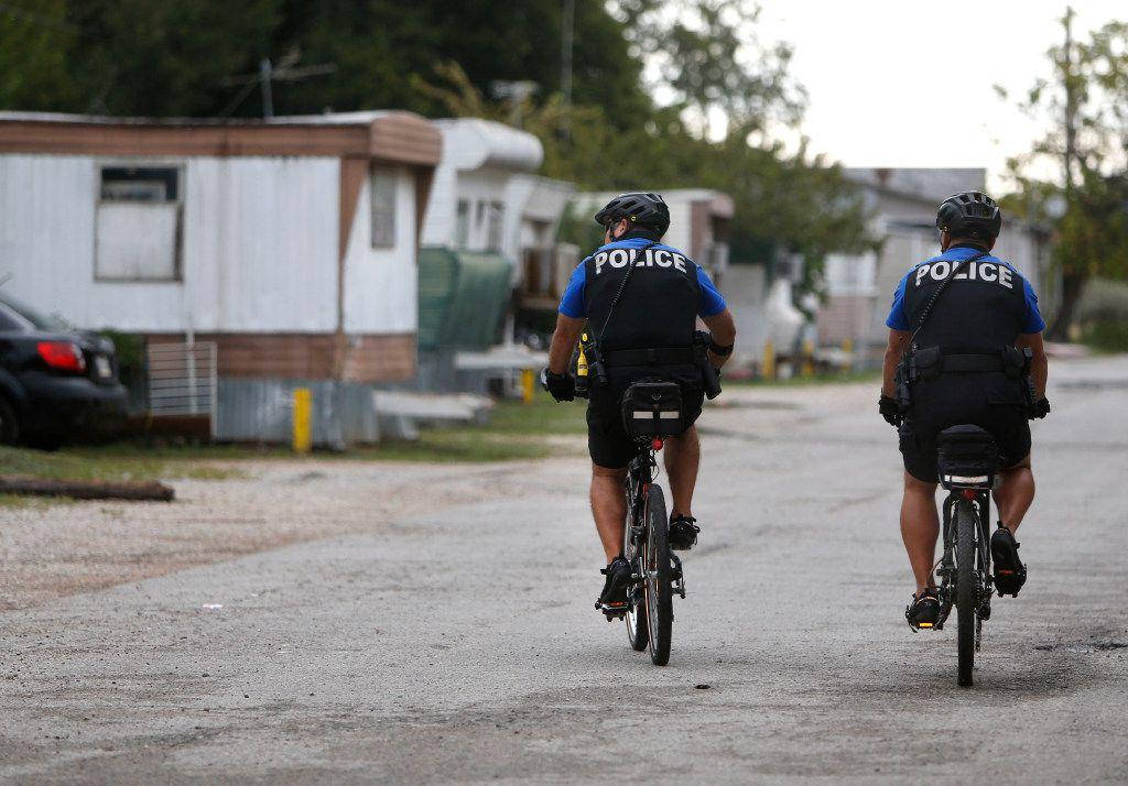 McKinney neighborhood police officers Randy Patton (right) and Sgt. Damian Guerrero patrol the neighborhood east of downtown McKinney. (Rose Baca/Staff Photographer)