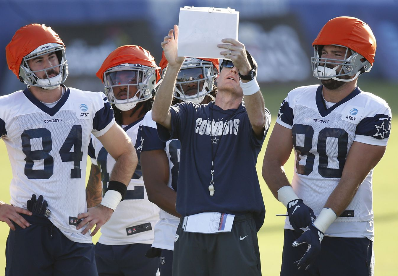 Dallas Cowboys special teams coach John Fassel goes over the next play with players during the first day of training camp at Dallas Cowboys headquarters at The Star in Frisco, Texas on Friday, August 14, 2020. (Vernon Bryant/The Dallas Morning News)