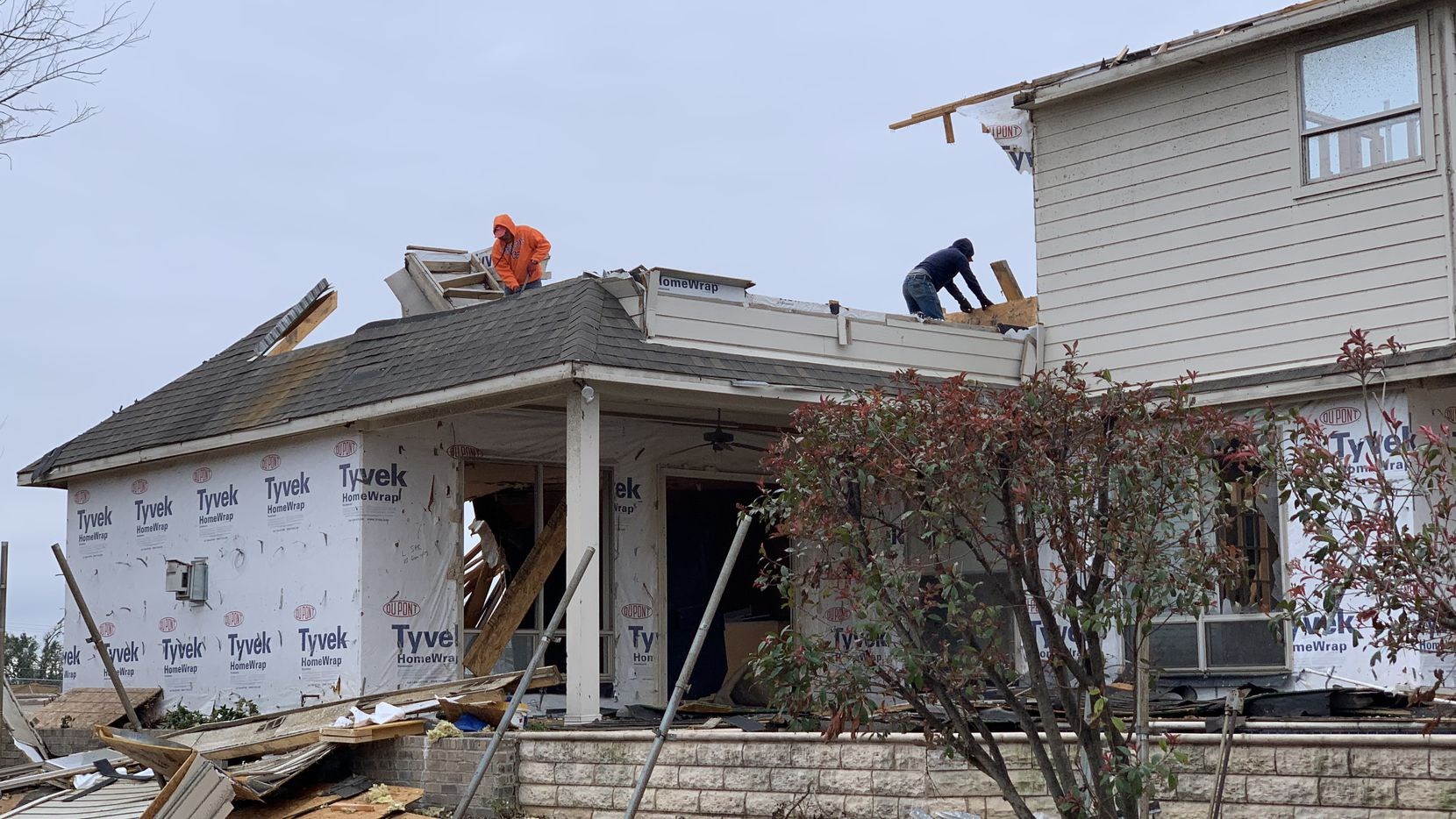 Workers are demolishing this house on Wimberley Court, near Walnut Hill and Marsh lanes in northwest Dallas. The home was walloped by a tornado that sliced through the area in October.