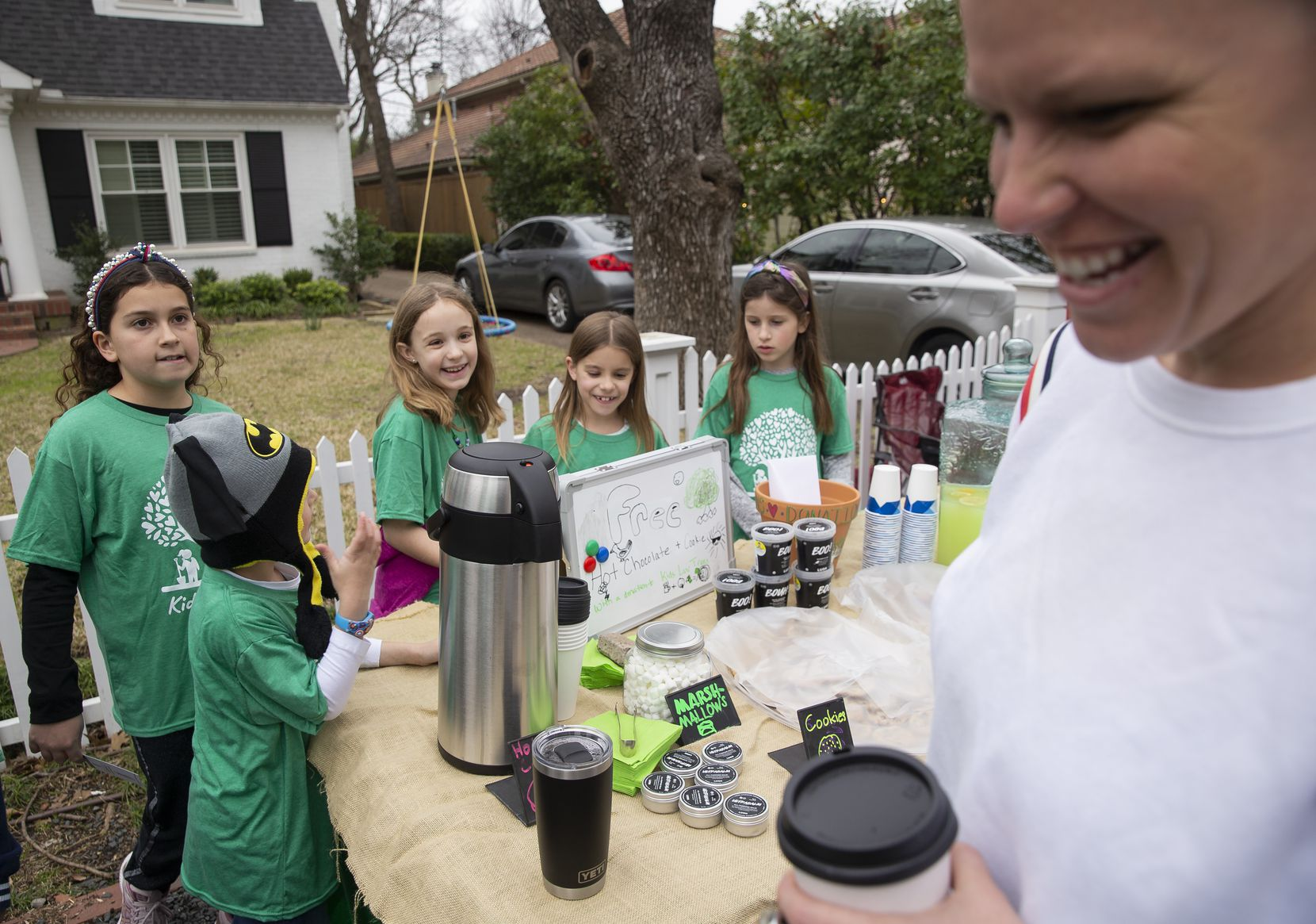 Hot chocolate from the Kids Luv Trees fundraiser put a smile on Shannon O'Brien's face.