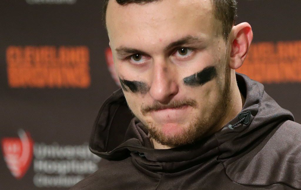 "FILE - In this Sunday, Dec. 20, 2015, file photo, Cleveland Browns quarterback Johnny Manziel speaks with media members after an NFL football game against the Seattle Seahawks, in Seattle. Tired of Manziel's off-field transgressions, some Browns fans have vowed not to discuss the quarterback on Twitter in February 2016. They've begun a ""Johnny Free February"" movement to refrain from mentioning Manziel on their social media accounts. (AP Photo/Scott Eklund, File)"