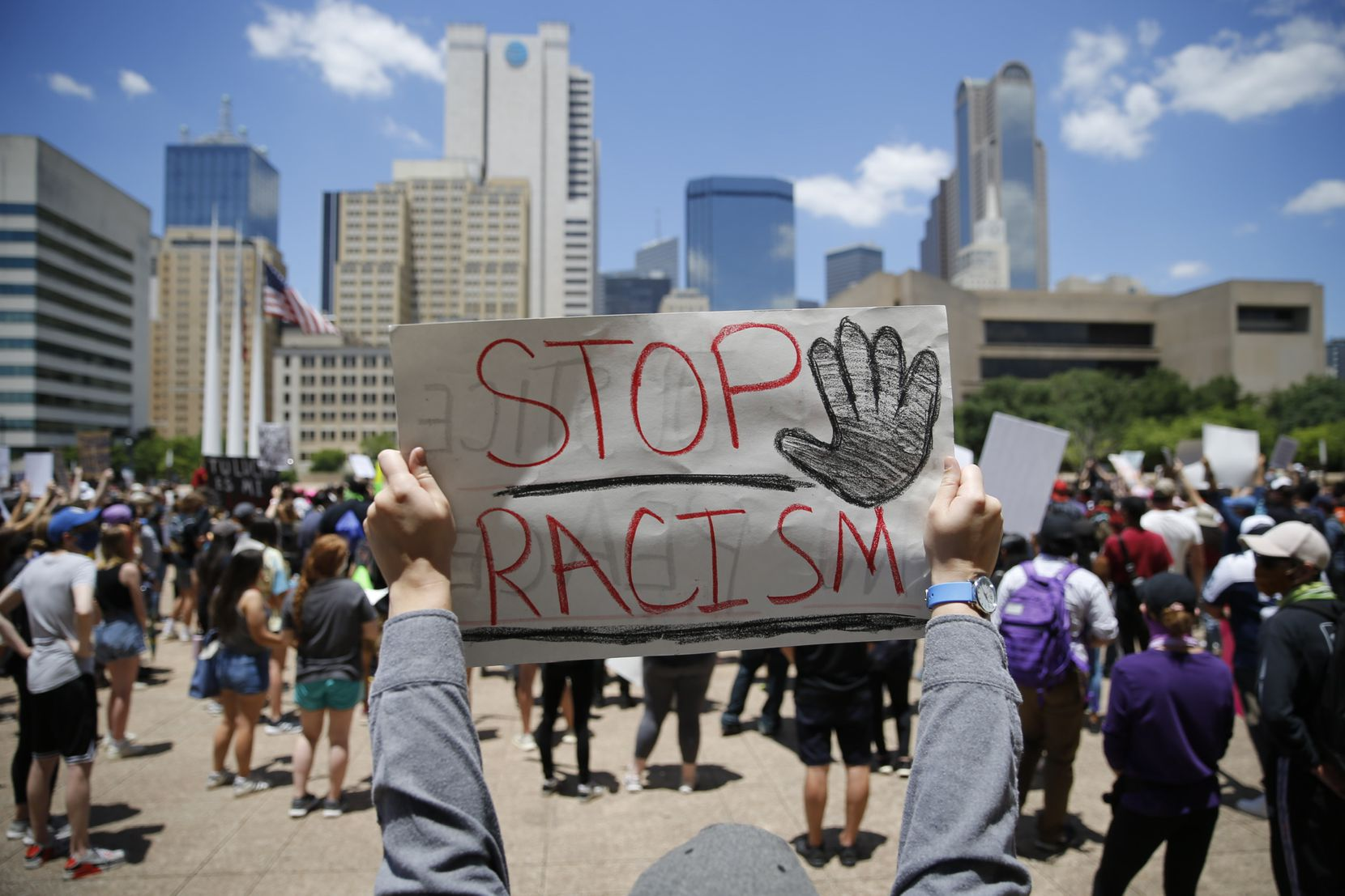 Protesters rally during a demonstration against police brutality in downtown Dallas, on Saturday. George Floyd died while in police custody in Minneapolis on Monday. Police Officer Derek Chauvin, who video showed holding his knee on the Floyd's neck for at least five minutes, has been charged with murder and manslaughter in the death.