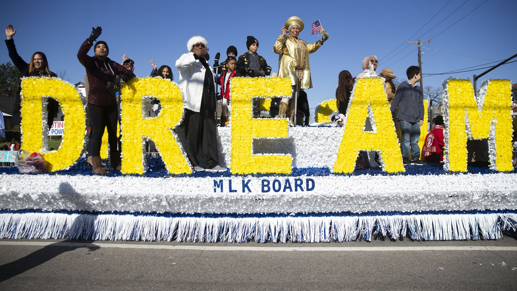 The MLK Board waves as they make their way down Martin Luther King Jr. Blvd during the 38th annual MLK Parade last January in Dallas.