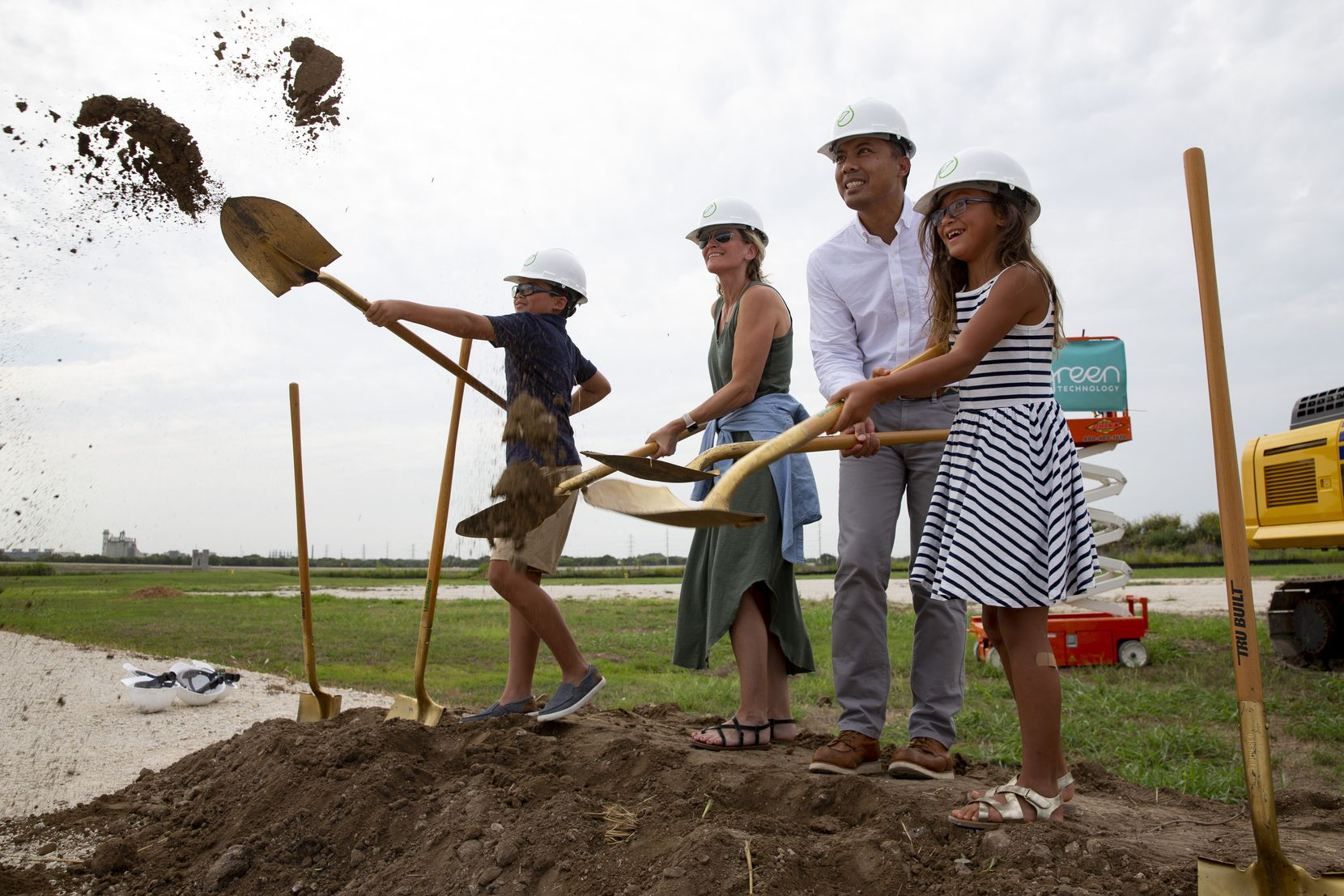 Eden Green CEO Eddy Badrina (second from right) breaks ground with his family on the company's new greenhouse.