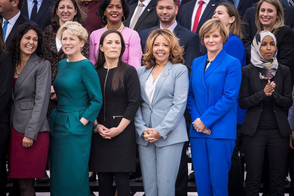 Democratic women in the front row at a photo for incoming House of Representatives freshmen, on Capitol Hill in Washington, Nov. 14, 2018. Xochitl Torres Small (left) of New Mexico; Chrissy Houlahan of Pennsylvania; Gina Ortiz Jones of Texas, whose race remains uncalled; Lucy McBath of Georgia; Susie Lee of Nevada; and Ilhan Omar of Minnesota.