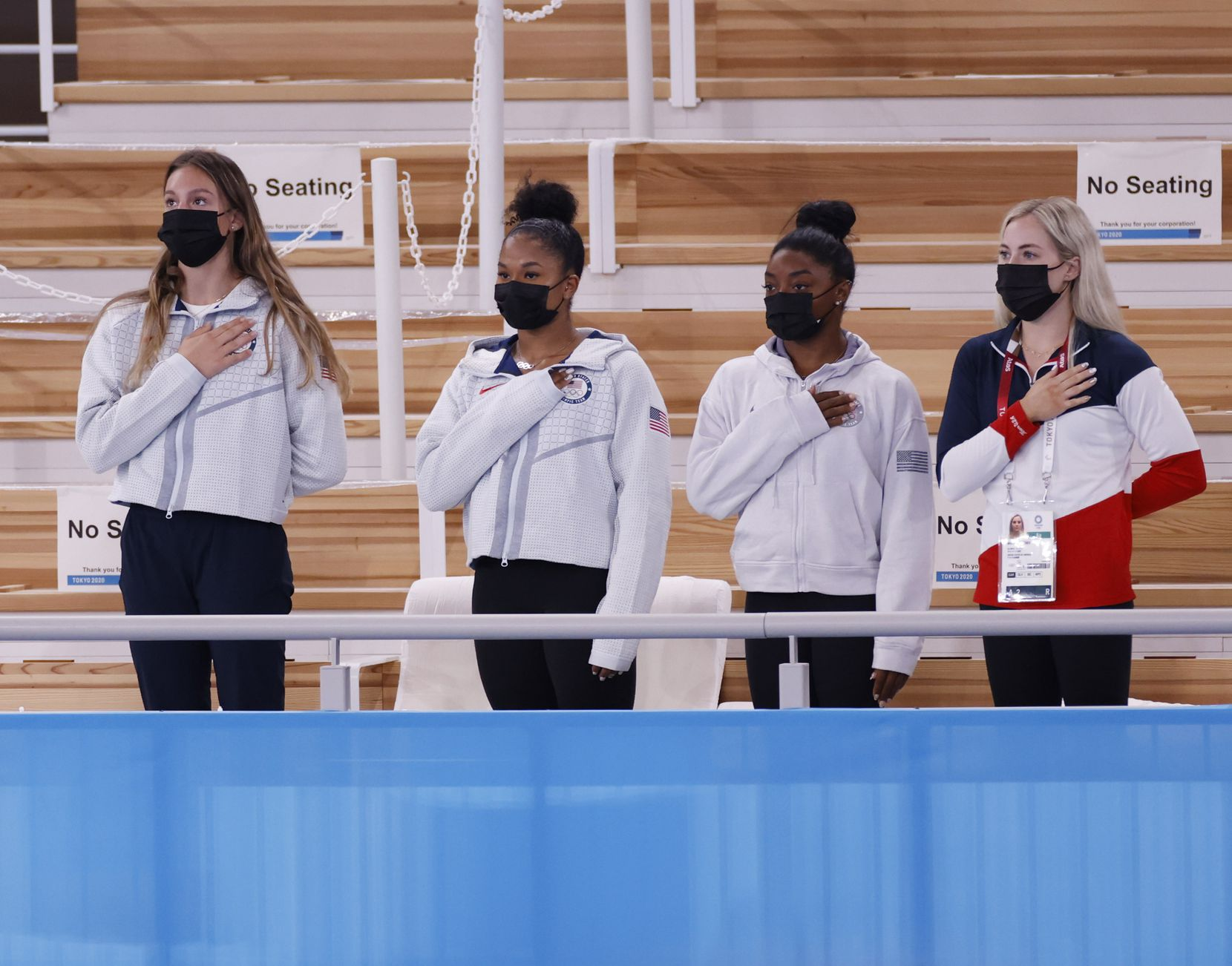 (From l to r) USA's Grace McCallum, Jordan Chiles, Simone Biles, and MyKayla Skinner stand during the playing of the national anthem after Sunisa Lee received her gold medal during the medal ceremony for the women's gymnastics individual all-around final at the postponed 2020 Tokyo Olympics at Ariake Gymnastics Centre, on Thursday, July 29, 2021, in Tokyo, Japan. (Vernon Bryant/The Dallas Morning News)