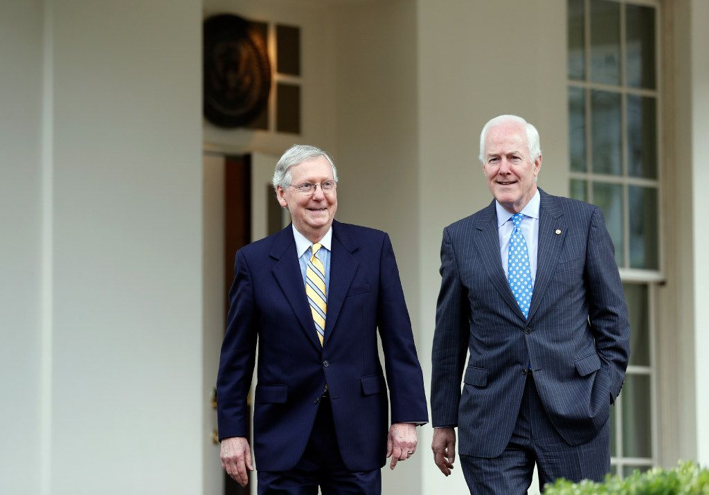 Senate Majority Leader Mitch McConnell of Ky., left, and Senate Majority Whip Sen. John Cornyn, R-Texas step out of the West Wing to speak with the media after they and other Senate Republicans had a meeting with President Donald Trump at the White House, Tuesday, June 27, 2017, in Washington.