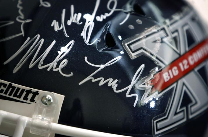 July 29, 2009: A football helmet on display during Big 12 Media Days bears the signature of Mike Leach and other conference coaches.