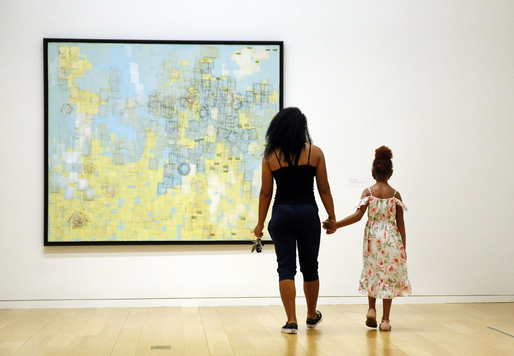 "Angela Burton of Fort Worth and her daughter Ava Burton view artist Mark Bradford's ""End Papers"" exhibition at the Modern Art Museum of Fort Worth."