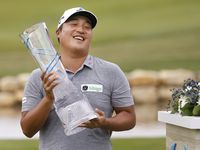 Kyoung-Hoon Lee lifts the trophy after winning the AT&T Byron Nelson at TPC Craig Ranch on Saturday, May 16, 2021 in McKinney, Texas.