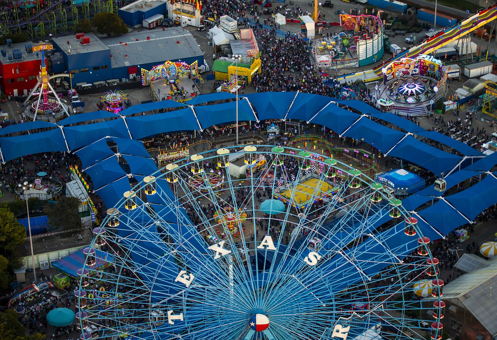 Crowds fill the midway at the State Fair of Texas in Fair Park on Saturday, Oct. 20, 2018, in Dallas.