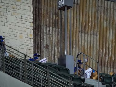 Texas Rangers starting pitchers, from left, Lance Lynn, Kyle Gibson, Jordan Lyles and Corey Kluber watch their teammates face the Colorado Rockies from rocking chairs on the Sky Porch high above left field during the third inning at Globe Life Field on Saturday, July 25, 2020.