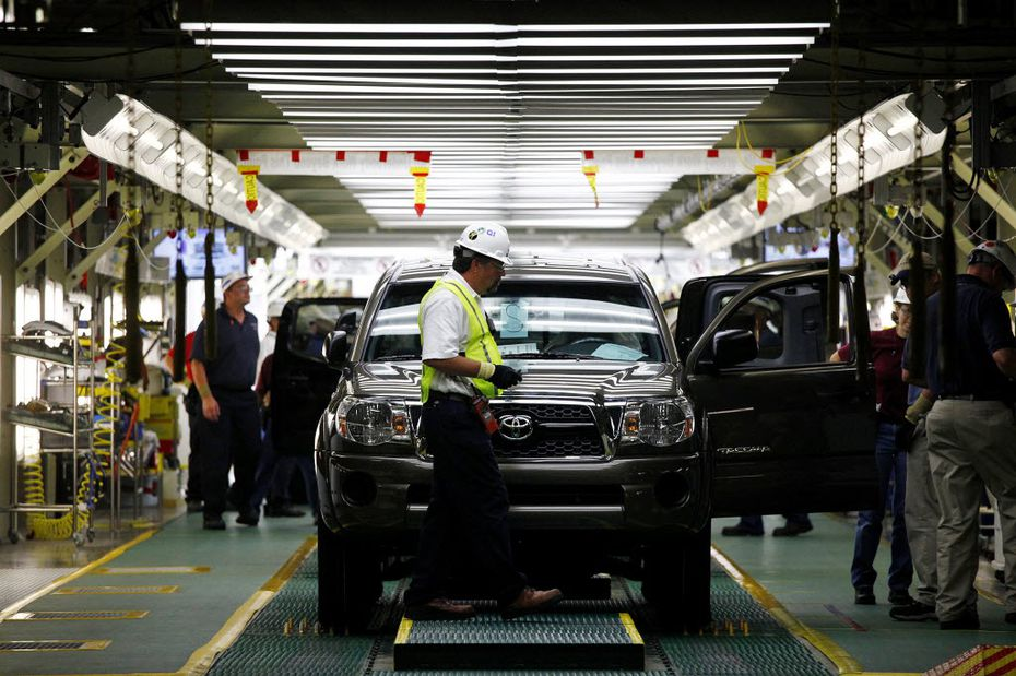 A Toyota Tacoma truck waits to come off the final inspection line at the Toyota's plant in San Antonio. (AP Photo/San Antonio Express-News, Lisa Krantz)
