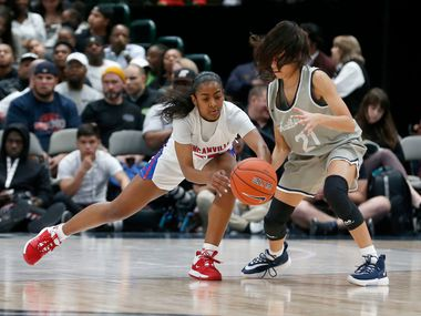 Duncanville player Deja Kelly (25) fights for the ball with Sierra Canyon's Sofia Ruelas (21) during their girls high school basketball game during the Thanksgiving  Hoopfest in Dallas, Tx, Saturday, Nov. 30, 2019. (Michael Ainsworth)