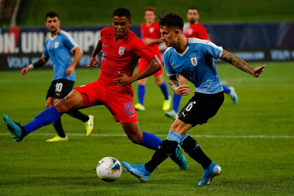 ST LOUIS, MO - SEPTEMBER 10: Brian Rodriguez #16 the Uruguay Men's National Team passes the ball against Reggie Cannon #20 of the United States Mens National Team at Busch Stadium on September 10, 2019 in St Louis, Missouri.