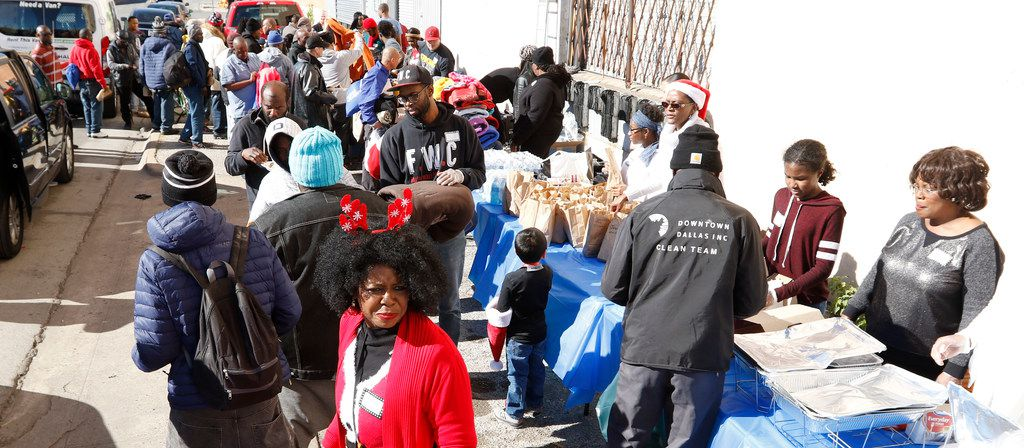 """""""These Are They"""" Homeless Outreach held their 1st Annual Holiday Helping Hand for the homeless on Saturday, Dec. 9, 2017, at Park Ave. and Marilla Street in downtown Dallas. DeAnna Brown, Executive Director, center, said they served hot meals, distributed hundreds of sleeping bags, blankets, clothes, coats, shoes and sack lunches on Saturday. They also serve 80 sack lunches every week on Park Avenue to the homeless."""