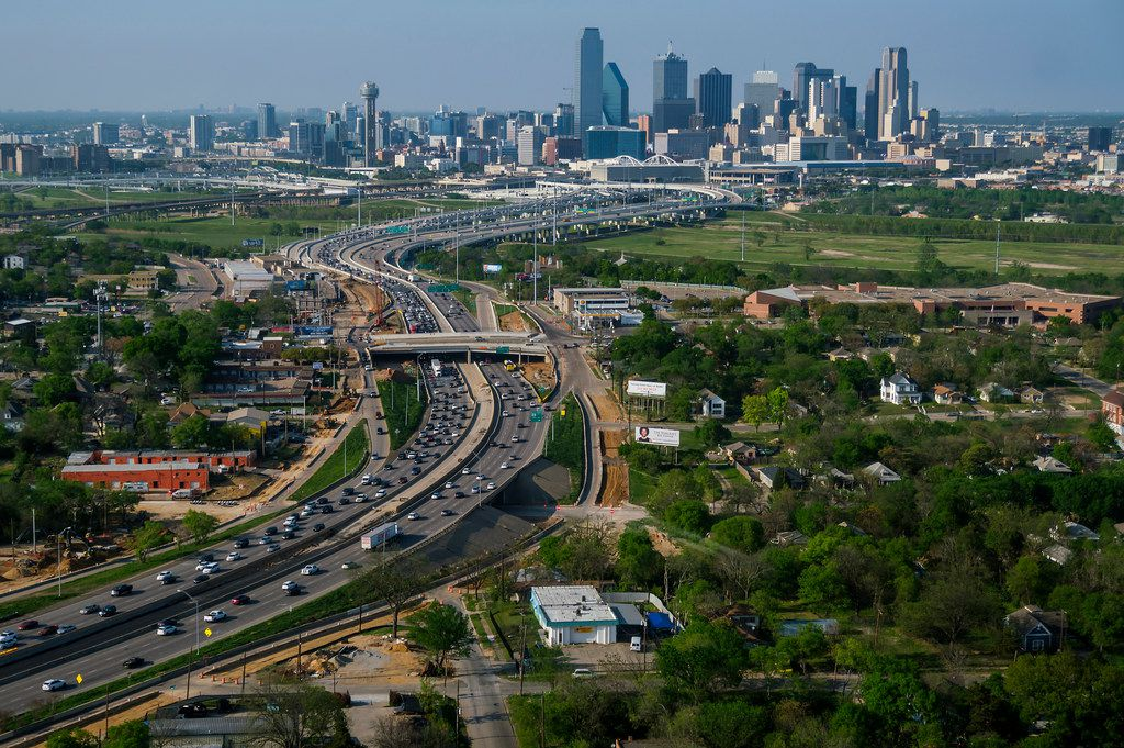 Aerial view of I-35  passing under Colorado Avenue in Oak Cliff and heading toward downtown on Thursday, April 4, 2019, in Dallas.