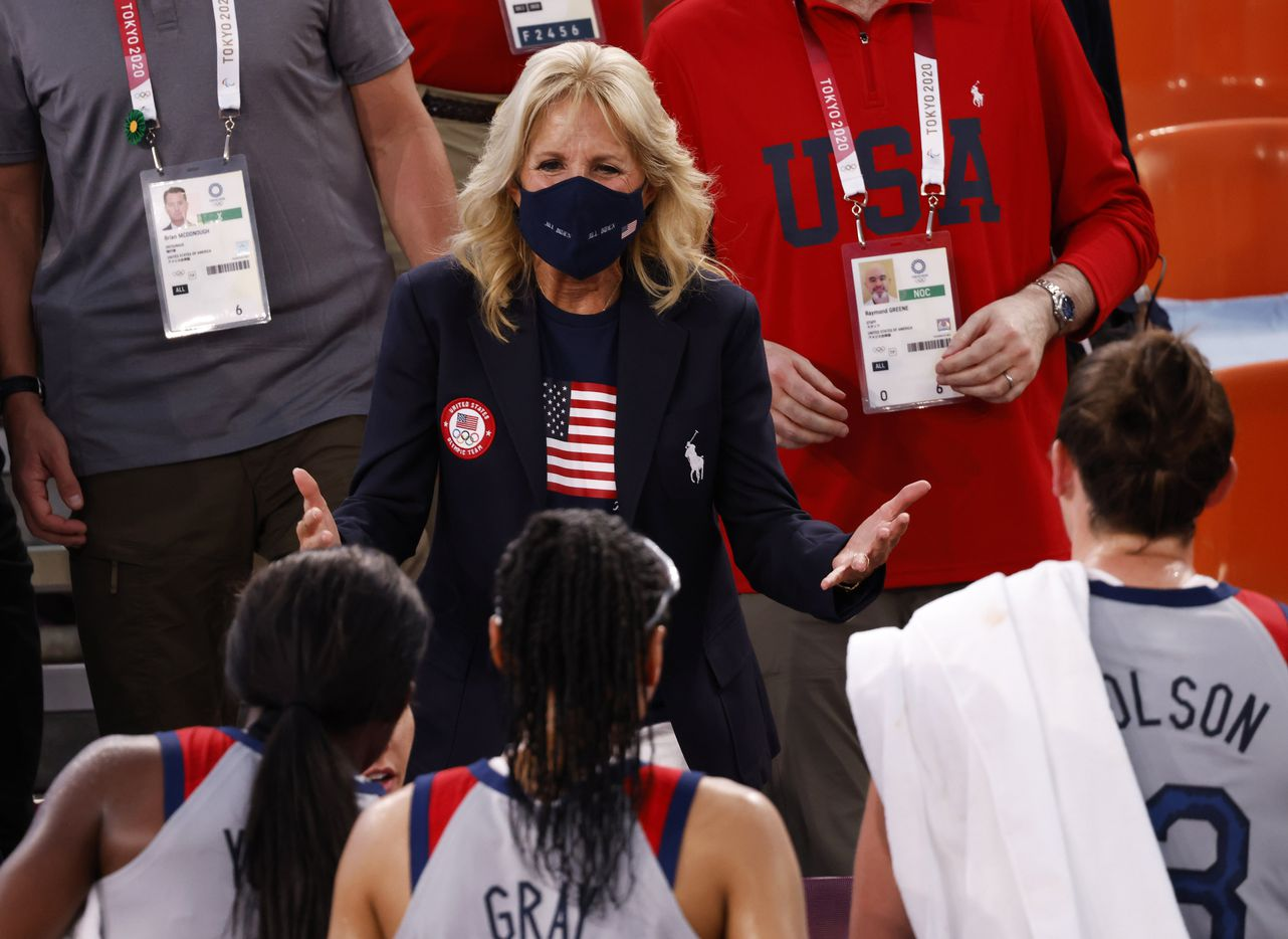 First lady Jill Biden talks with USA players after their victory over France 17-10 in a 3x3 women's basketball game during the postponed 2020 Tokyo Olympics at Aomi Urban Sports Park on Saturday, July 24, 2021, in Tokyo, Japan. (Vernon Bryant/The Dallas Morning News)