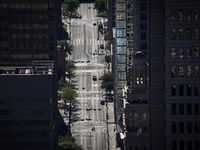 The typically congested Main Street in downtown Dallas shows the effect of coronavirus and travel restrictions on city traffic in this aerial photo taken at 5 p.m. on a recent workday.