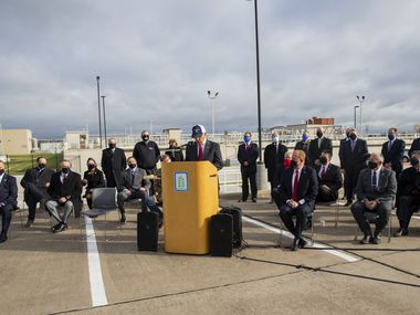 Representatives of the 13 member cities of the North Texas Municipal Water District and water district board members gathered Thursday morning in one of the parking lots at the massive water complex to sign an amended contract governing wholesale water rates.