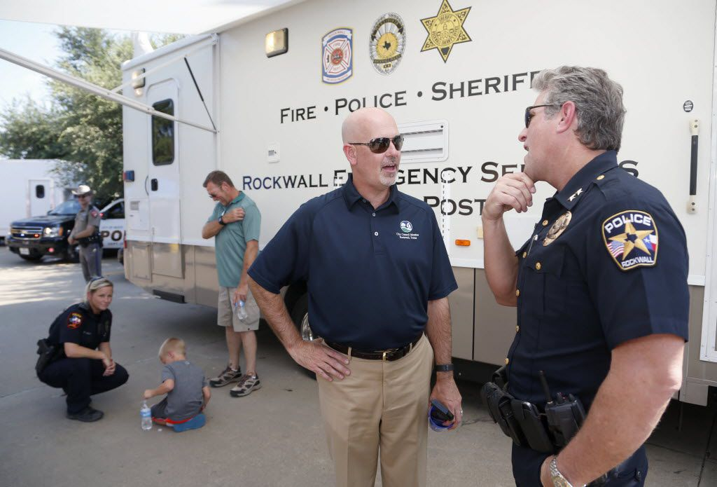New Rockwall City Council member Kevin Fowler (center) talks to new Rockwall Police Chief Kirk Riggs during a National Night Out event at a Home Depot parking lot in Rockwall in 2015.