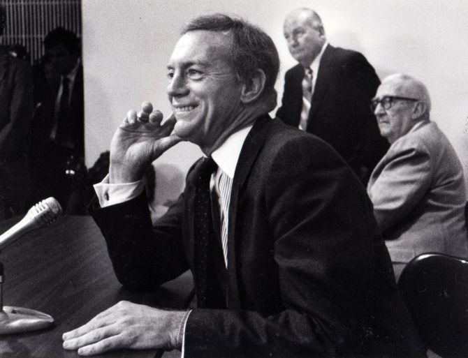 Jerry Jones, with former Cowboys general manager Tex Schramm (standing) and Bum Bright in the background, took Dallas by storm when he bought the Cowboys in 1989.