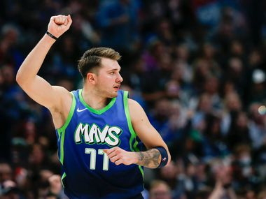 Dallas Mavericks forward Luka Doncic (77) celebrates sinking a three pointer during the second half of a NBA matchup between the Dallas Mavericks and the Sacramento Kings on Sunday, Dec. 8, 2019 at American Airlines Center in Dallas.