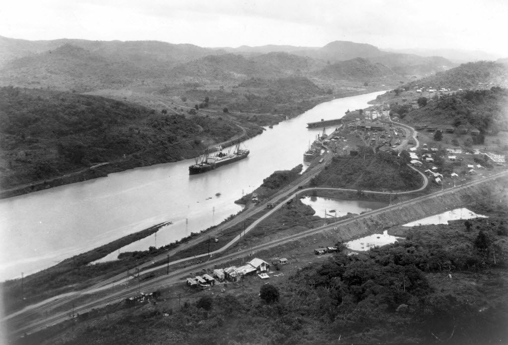 This Aug. 15 , 1914, file photo shows the New York-registered SS Ancon crossing the Culebra cut of the Panama Canal on opening day, as seen from Cerro Luisa, looking north.