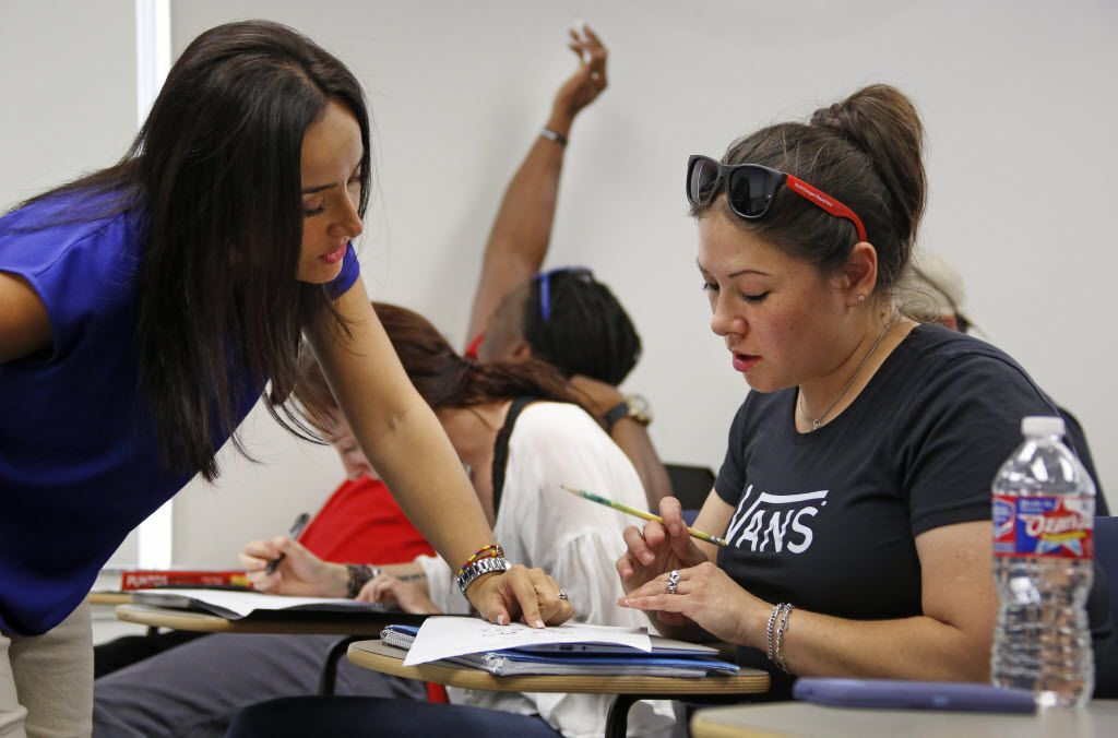 Wendy Birdsall gets some help from instructor Ana Melgarejo Acosta's in Spanish class at SMU on Wednesday, September 23, 2015. (Louis DeLuca/The Dallas Morning News)