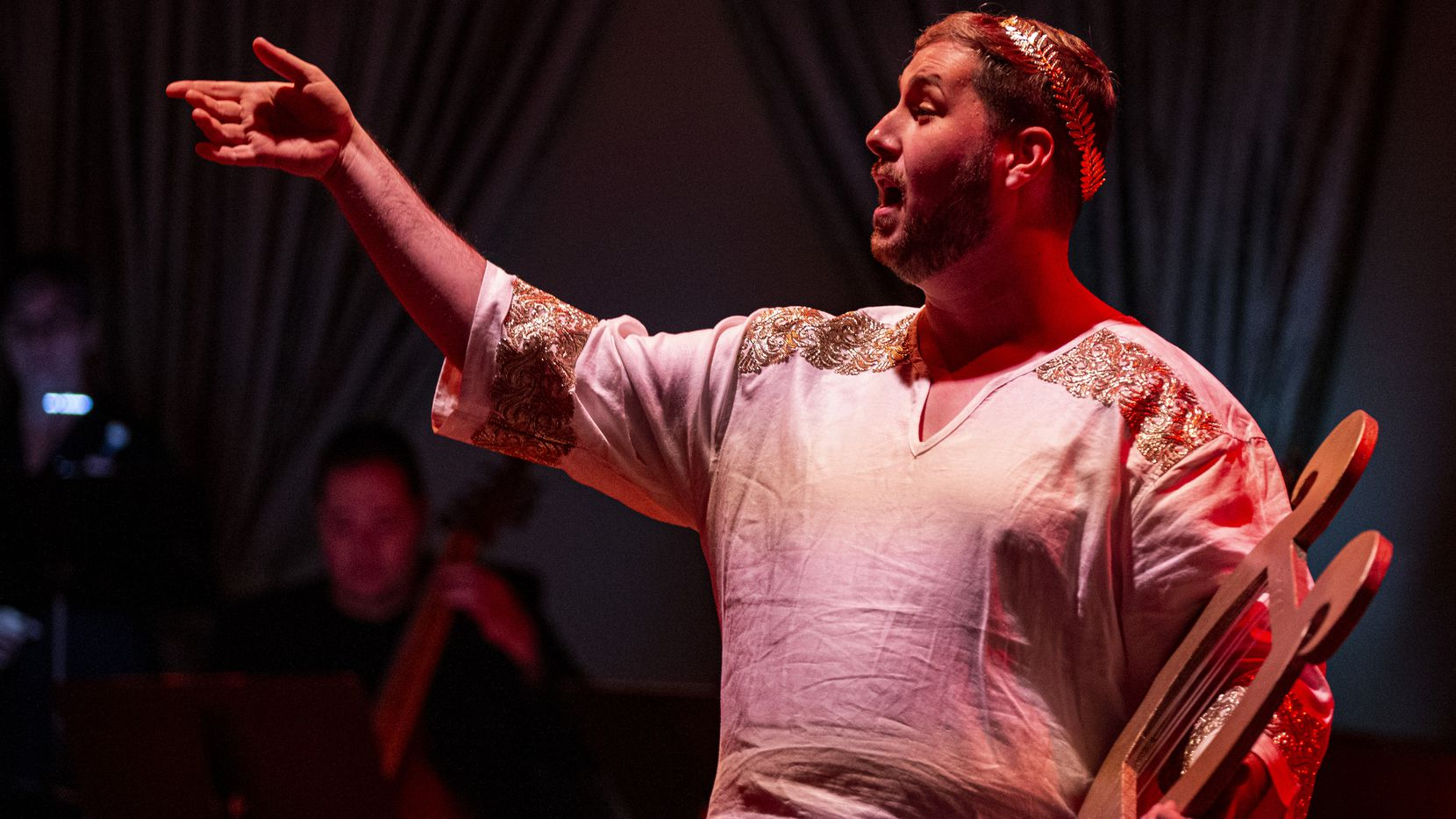 """Nicholas Garza performs as Orphée during a dress rehearsal of American Baroque Opera Co.   production of Marc-Antoine Charpentier's opera """"La descent d'Orphée aux enfers"""" at the Sammons Center for the Arts in Dallas on Oct. 31, 2019."""